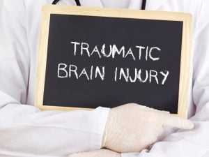 Gulfport traumatic brain injury lawyer - chalkboard sign reads traumatic brain injury